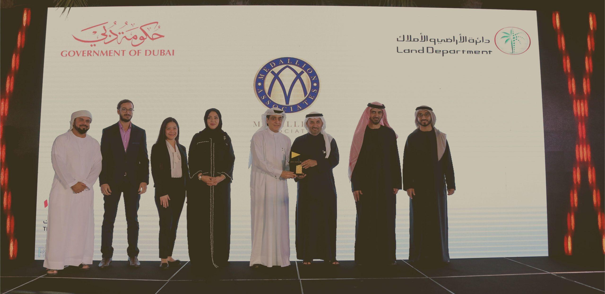 DLD award ceremony medallion associates